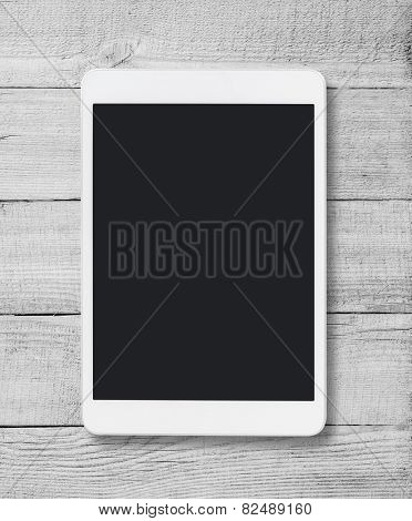 Tablet pc similar to ipad on wood table background