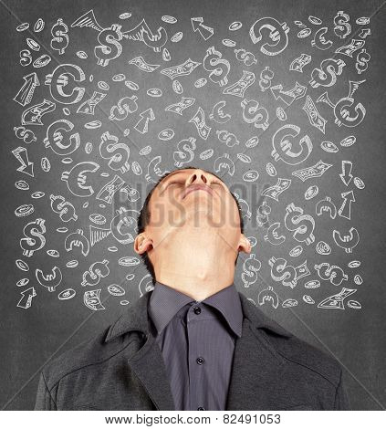 Idea concept with businessman looking upwards on sketch background