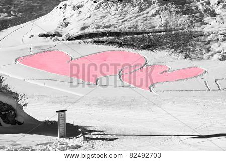 Red Hearts Carved In Snow As A Saint Valentine's Greeting