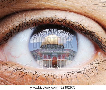Closeup of human eye, macro mode with double exposure and Masjid al-Aqsa mosque in Jerusalem
