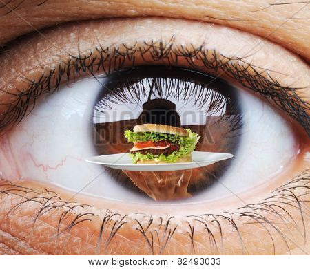 Closeup of hungry human eye macro mode with double exposure and fast food burger in