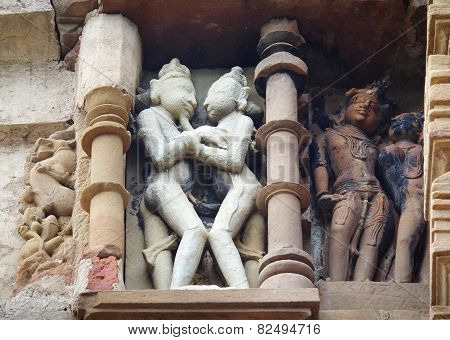 Stone carved erotic bas relief in Hindu temple in Khajuraho, India.