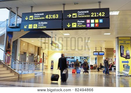 VALENCIA, SPAIN - February 7, 2015: Airline passengers inside the Valencia Airport. About 4.98 million passengers passed through the airport in 2014.