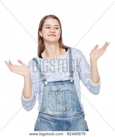 Young Fashion Girl In Jeans Overalls Shrugging Isolated