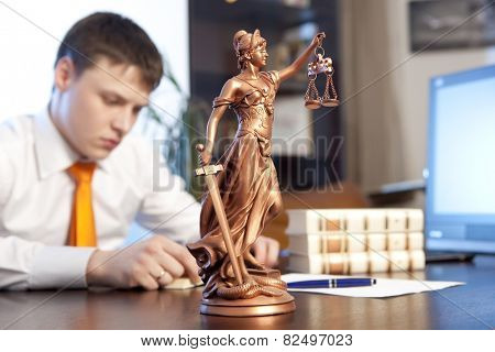 Lawyer reading a book in the office