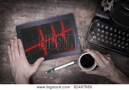 Electrocardiogram On A Tablet - Concept Of Healthcare