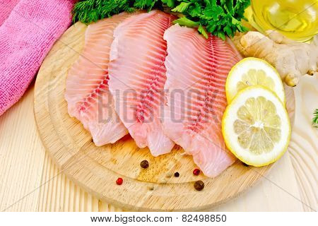 Tilapia with oil and lemon on board