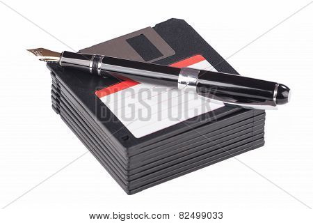 Fountain Pen Lying On A Pile Of Floppy Disks