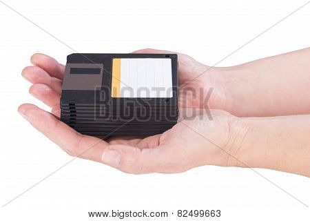 Female Hands Holding Floppy Disks