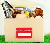 image of yard sale  - Box of unwanted stuff ready for a garage sale - JPG