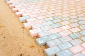 foto of paving stone  - Colored brick paving stones in construction process - JPG