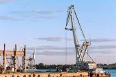 foto of barge  - Floating cargo crane on barge near quay - JPG