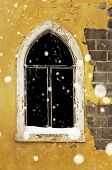 foto of forlorn  - Gothic window of abandoned building on a snowy day - JPG