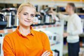 stock photo of supermarket  - Positive seller or shop assistant portrait  in supermarket store - JPG