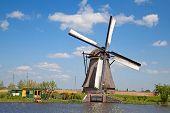 stock photo of windmills  - Ancient windmills near Kinderdijk - JPG