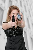 image of guns  - Beautiful police detective woman on the job with a gun - JPG