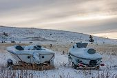 stock photo of ski boat  - Boat and jet ski collecting snow during the winter - JPG