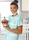 foto of dentures  - Attractive young dental assistant smiling happy - JPG