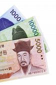 stock photo of won  - Set of Korean Won currency bills isolated on a white background - JPG