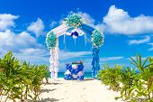 stock photo of wedding arch  - beautiful decorated wedding arch on sand beach - JPG