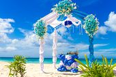 picture of wedding arch  - beautiful decorated wedding arch on sand beach - JPG