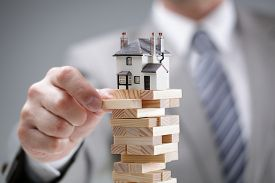 stock photo of risk  - Investment risk and uncertainty in the real estate housing market - JPG