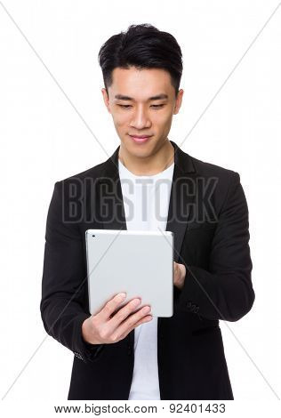 Asian young man use the digital tablet