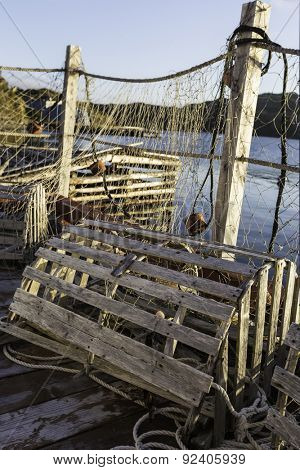 Old wooden lobster trap with fishing nets on a Newfoundland dock.
