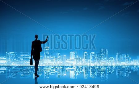 Rear view of businesswoman looking at city panorama