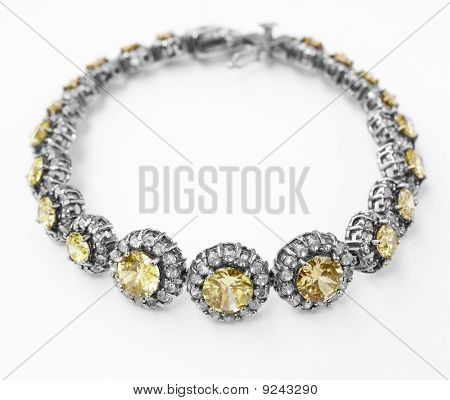 silver and diamonds bracelet with yellow topaz stone on white background