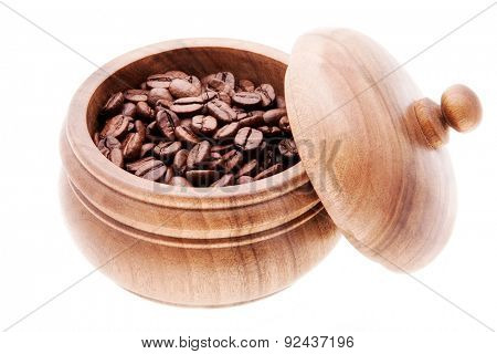 coffee in a wooden container with the lid open. Isolated on white background