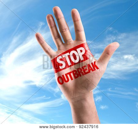 Open hand raised with the text: Stop Outbreak on sky background