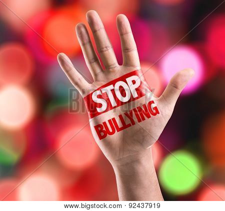 Open hand raised with the text: Stop Bullying with bokeh background
