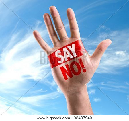 Open hand raised with the text: Say No! on sky background