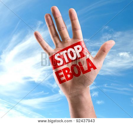 Open hand raised with the text: Stop Ebola on sky background