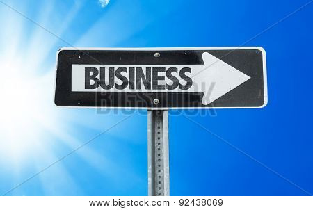 Business direction sign with a beautiful day