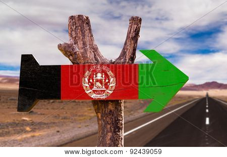 Afghanistan Flag wooden sign with desert road background