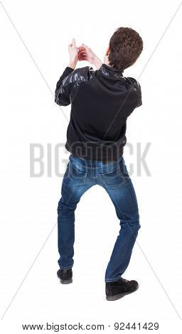 back view of standing man pulling a rope from the top or cling to something.  Rear view people collection.  backside view of person.  Isolated over white background. Crouching guy pulling a rope