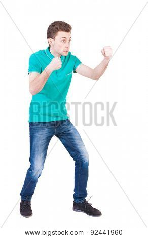 skinny guy funny fights waving his arms and legs. Isolated over white background. Funny guy clumsily boxing. Enraged man in a boxing pose.