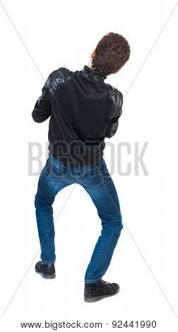 back view of standing man pulling a rope from the top or cling to something.  Rear view people collection.  backside view of person.  Isolated over white background.  Crouching guy.