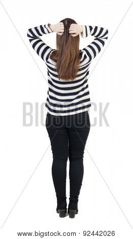 Back view shocked woman in jeans. girl hid his eyes behind his hands. Rear view people collection.  backside view person. Isolated over white background. girl in striped sweater is clutching his head