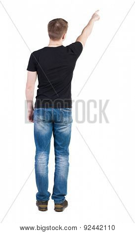 Back view of  pointing young men in  t-shirt and jeans. Young guy  gesture. Rear view people collection.    Isolated over white background. A man in a black jacket and is showing one of his hands up.