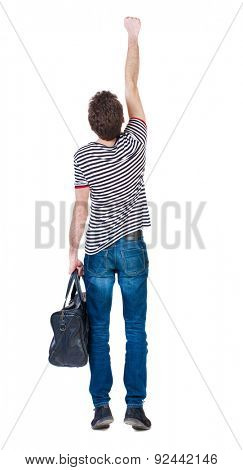 Back view of  man with bag.  Raised his fist up in victory sign.  Rear view people collection.  backside view person.  Isolated over white background. guy in flying Superman pose with fashionable bag.