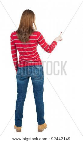 Back view of  pointing woman. beautiful girl. Rear view people collection.  backside view of person.  Isolated over white background. The blonde in a red striped sweater right thumb presses button.