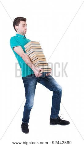 Back view going  handsome man carries a stack books. walking young guy . Rear view people collection. backside view person. Isolated over white background. High school student carries book in library
