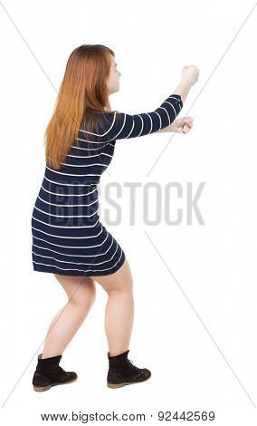 back view of standing girl pulling a rope from the top or cling to something. girl  watching.  backside view of person.  Isolated over white background. Sitting woman pulling a rope on top