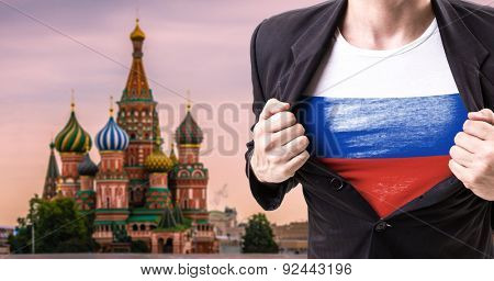 Businessman stretching suit with St Basils cathedral on background