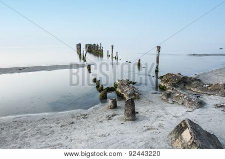 Old broken pier on the coast of the Baltic sea, Latvia