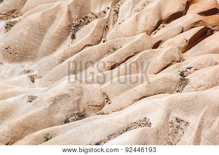 Detailed photo of vivid pink rock formations from above in Cappadocia, Turkey