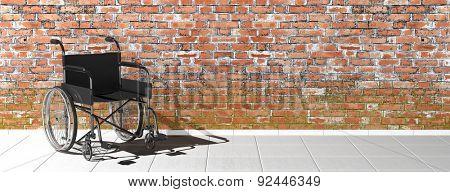 Black disability wheelchair near brick wall